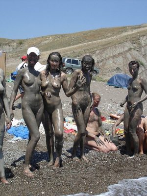Nudist having fun with mud
