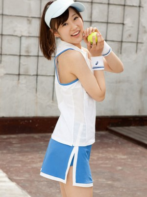 Shows flexibility playing with playing tennis ball