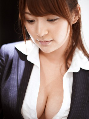 Meguri Oriental in tight top shows her huge bra-stuffers in white bra