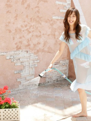 Rola Chen Oriental plays with outside shower on body over underware