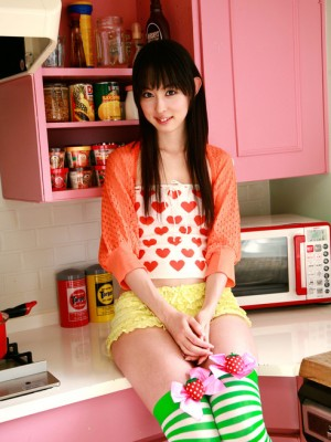 Rina Akiyama Oriental in long colorful clothes likes some candies