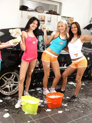 Four teenage car washing women playing with their twats