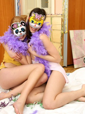 Two excited and sapphic legal age teenagers wearing kinky masks fucking