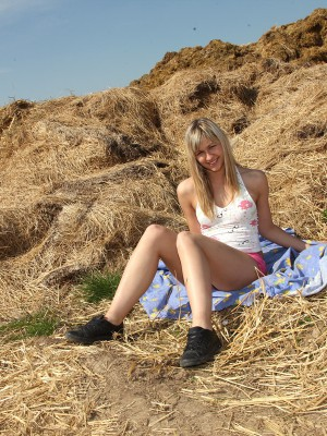 Big red dildo joys a cute blond girl outdoors