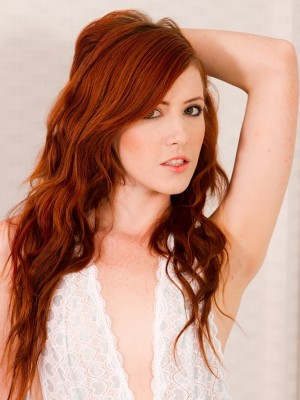 Stunning redhead Elle Alexandra undressed in only heels.