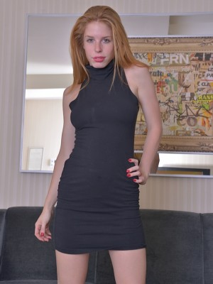 Puffy redhead Alexia Sirens stretches fur covered pussy.
