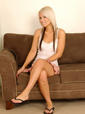 Blond babe getting bare on her daybed
