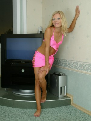 Blond Russian sweetheart in a cool pink outfit