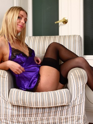 Nice blond girl stretches her sweet shaven cootchie