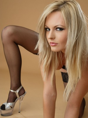 Cute blond looks gorgeous in her black hold-ups