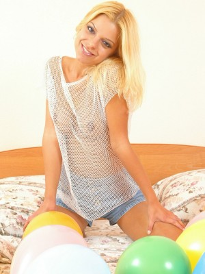 Nice golden-haired stretches her enchanting clean-shaved pussy