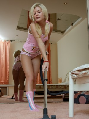Cute golden-haired teenage draining on the bed with a dildo
