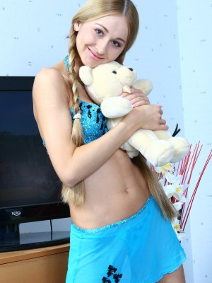 Lovely teenage with bear shows pussy in bedroom