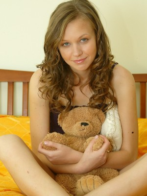 Adorable Ukrainian teen poses on her bed