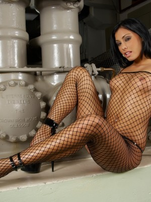 Industrial setting in her see through body stocking