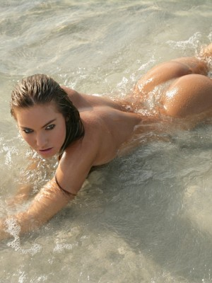 Bare babe taking a swim in the river