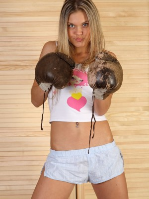 Pretty young blond widens her sweet snatch in boxing gloves