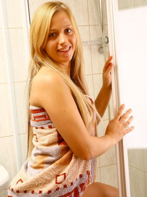 Hawt youthful golden-haired flashing leaking pussy in shower