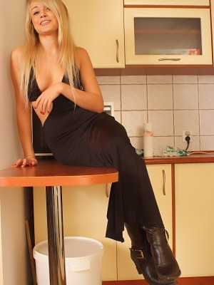 Sitting on the kitchen counter disrobing