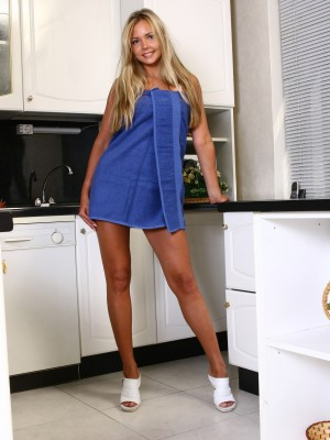 Erotic dancing on her kitchen counter