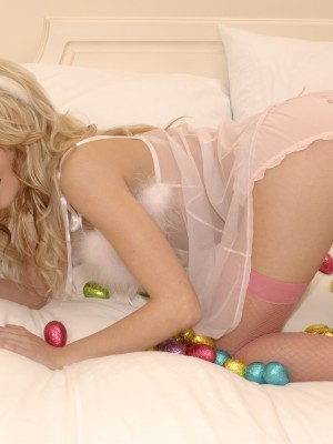 Breathtaking young golden-haired masturbates her honeypot with chocolate eggs