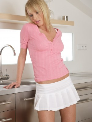 Sweet blond chick glides two fingers in her soaked labia