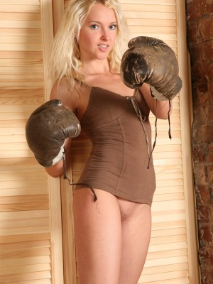 Sweet blond teen exposes her luxurious vulva in boxing gloves