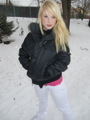 Pleasing golden-haired legal age teenager shows her cute mambos and pussy in the snow