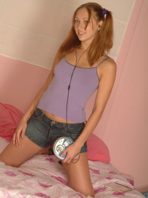 Teenage chick looks hot with her pigtails
