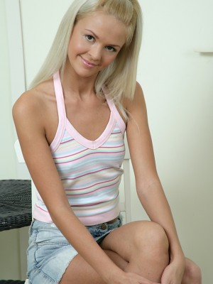 Blond cutie Faith pulls up her petticoat to show off her pink -panties.