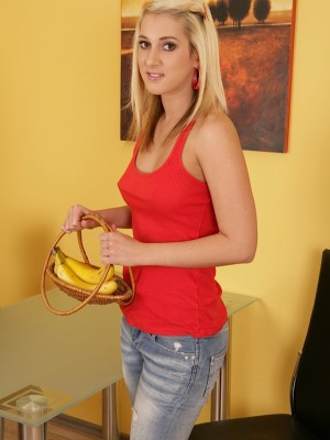 Cute blonde Laila Star eats a banana with her merry breasts out.