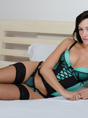 Cute brunette hair coed Tess wearing only her fishnet stockings.