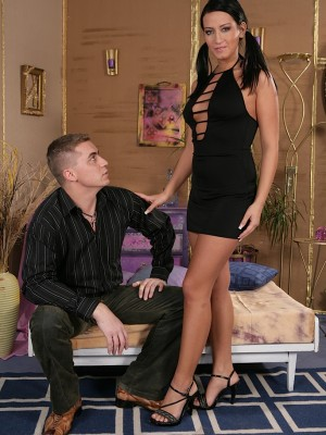 Dark haired darling Carmen deep-throats on a fat cock.