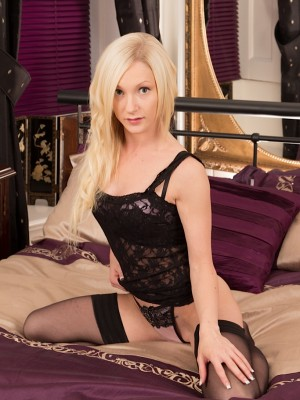 Gorgeous blonde honey Chloe bare in only black stockings.