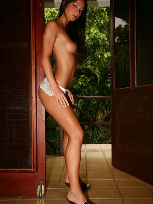 Tanned and elegant Melisa is a long legged stunner.