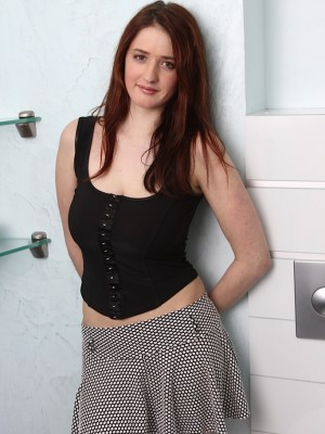 Breasty redhead Maria Beaumont toying her wet pussy.