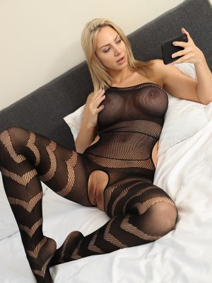 Nathaly Cherie is wearing a crotchless full body stocking.